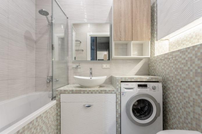 comptoir au-dessus de la machine à laver dans la salle de bain
