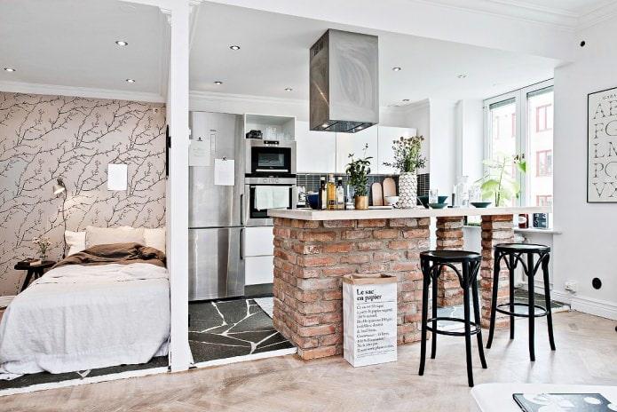 conception de cuisine scandinave avec comptoir de bar en brique
