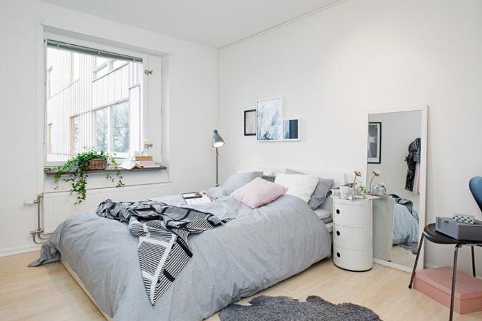 Intérieur de chambre scandinave dans des couleurs claires