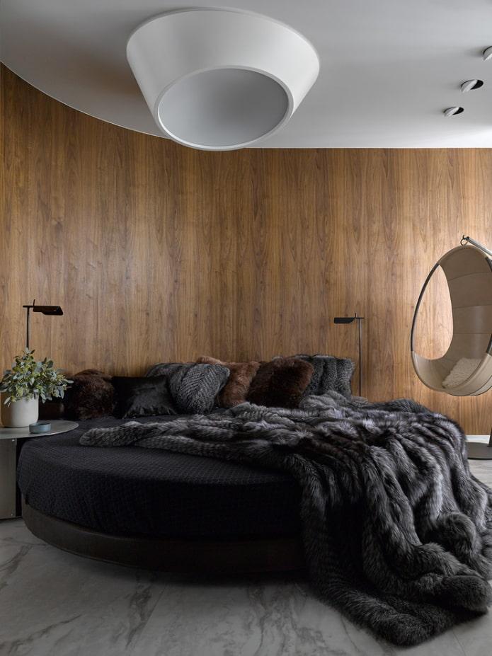 lit rond avec un couvre-lit à l'intérieur