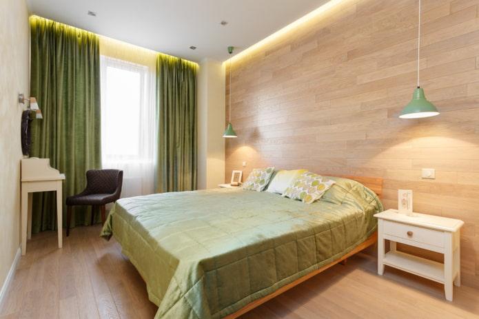 lit avec couvre-lit vert dans la chambre