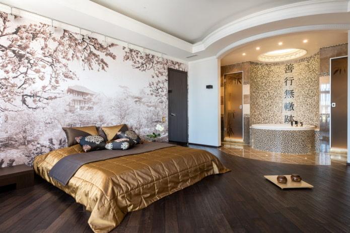 lit avec un couvre-lit doré dans la chambre