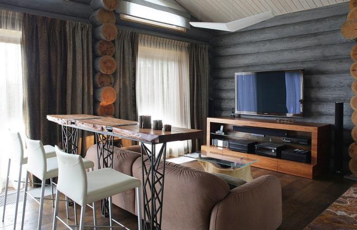 comptoir de bar derrière le canapé à l'intérieur de la salle