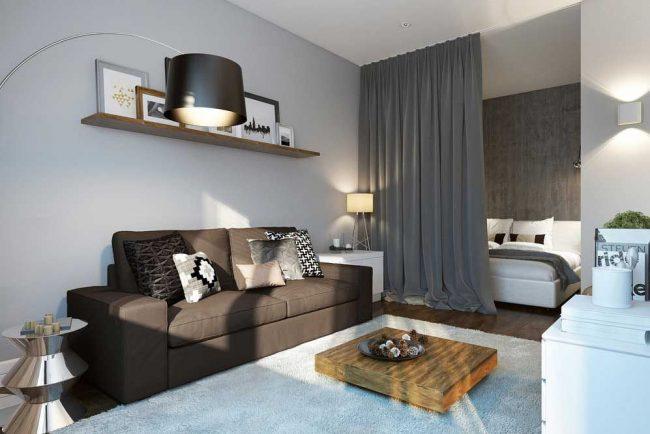 Appartement d'une pièce avec un coin couchage séparé avec un rideau