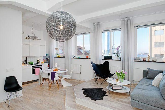 Conception d'un appartement d'une pièce avec une cuisine combinée dans le style Art Nouveau