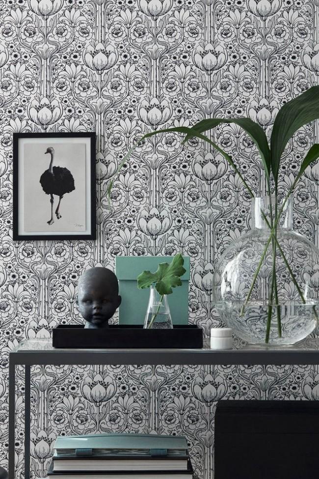 Le motif de papier peint noir et blanc convient à un intérieur moderne