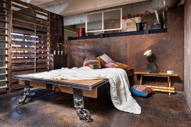 Chambre d'un petit espace au style industriel