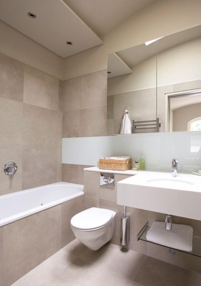 Les mêmes carreaux ont été choisis pour le revêtement de la salle de bain et pour les murs.
