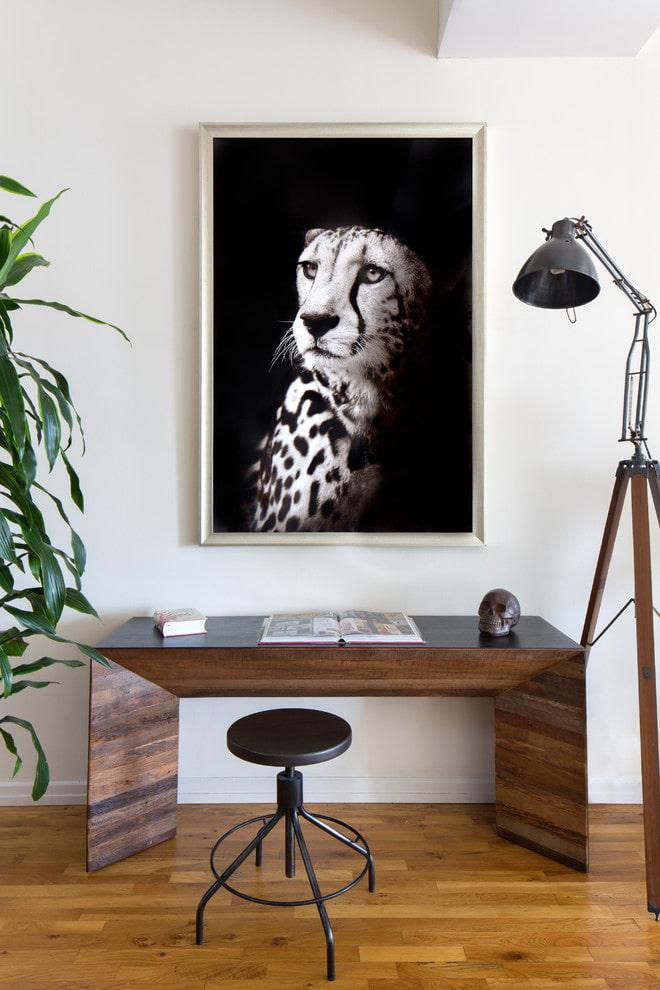 peinture avec une photo d'un guépard à l'intérieur