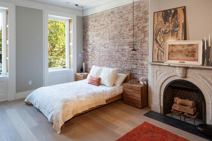 Papier peint sous brique rouge dans la conception de la chambre