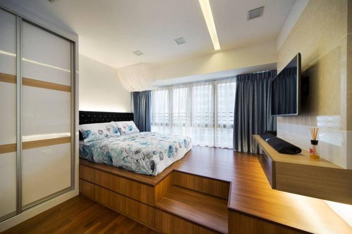 lit sur le podium à l'intérieur de la chambre