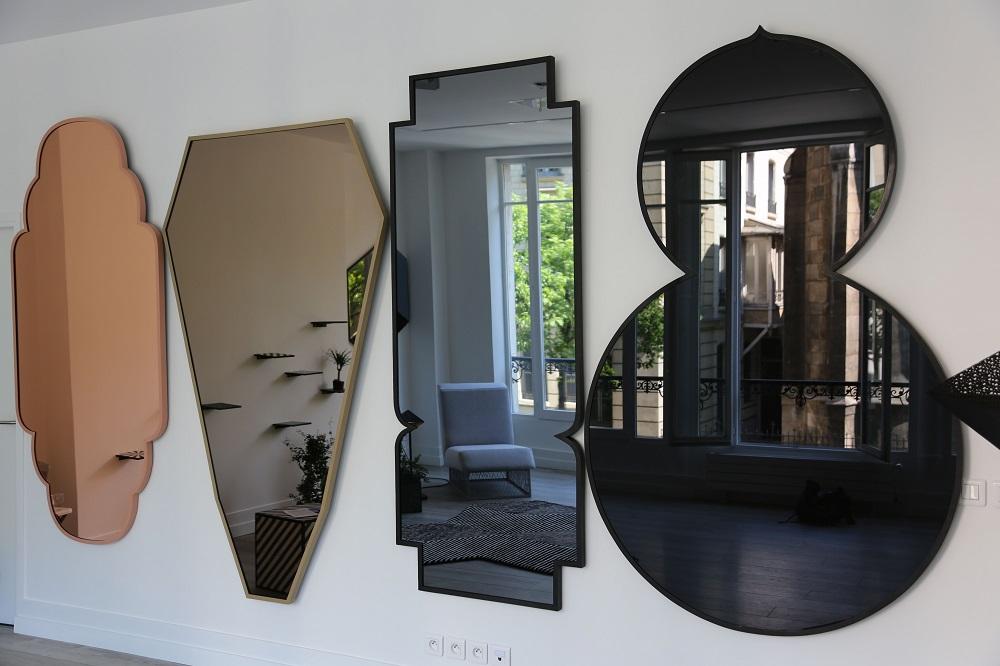 Quatre surfaces réfléchissantes de formes différentes