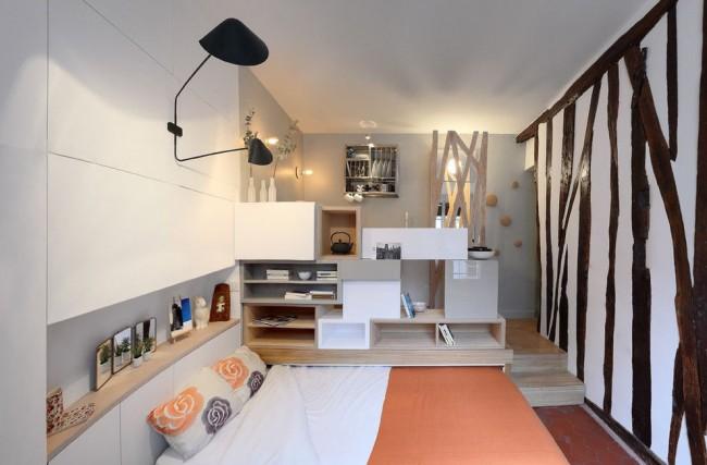 Intérieur multifonctionnel d'un appartement d'une pièce moderne, où le mobilier est transformé et change de destination à la demande du propriétaire