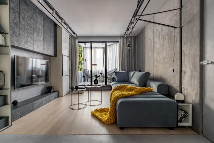 Salon gris avec une couverture lumineuse