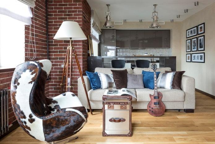 Fauteuil en cuir, coffre, canapé avec coussins
