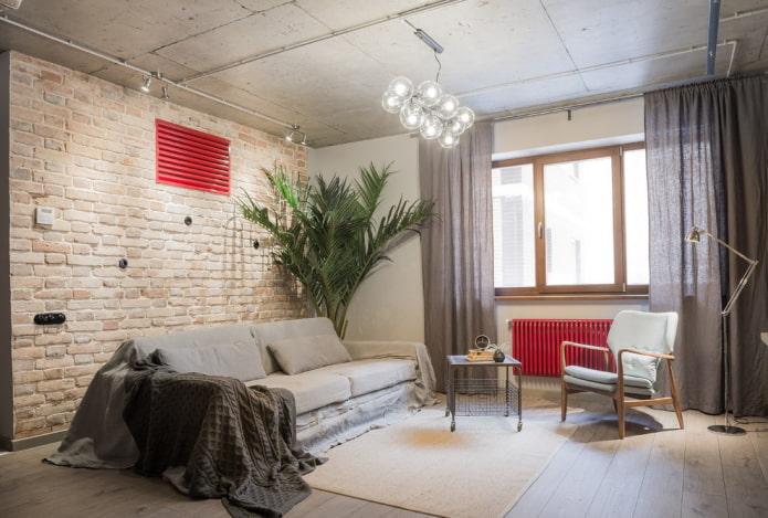 Salon gris et détails rouges