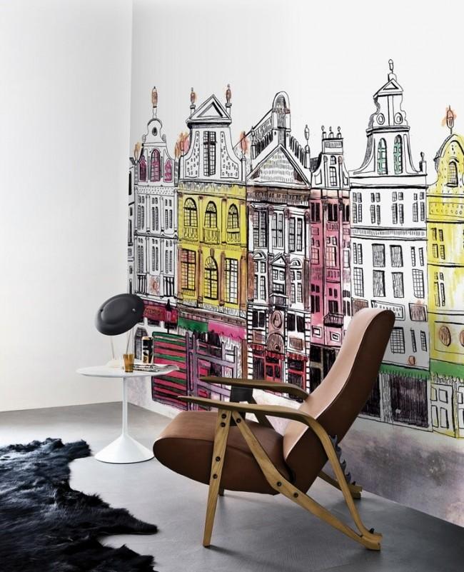 Un dessin intéressant sur le mur dans des couleurs chaudes complète l'ambiance générale de la pièce