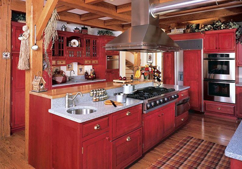 Cuisine rouge dans un style campagnard - design d'intérieur