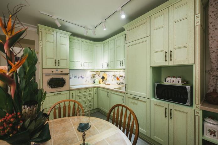 conception de cuisine dans des couleurs vert pâle