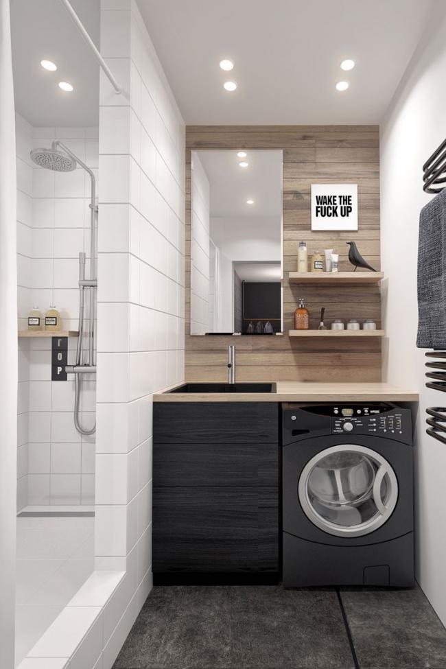 Emplacement pratique de la machine à laver sous le comptoir dans la salle de bain