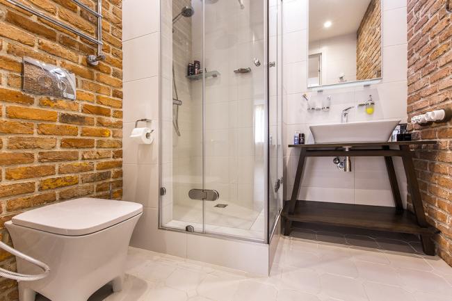 La maçonnerie contribuera à souligner le style loft de votre intérieur