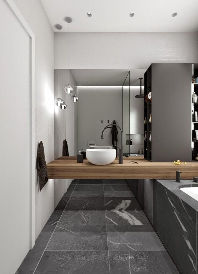 Le petit lavabo (45 cm) est situé sur le plan de travail suspendu au-dessus de la baignoire.  Ainsi, la légèreté visuelle et la non-congestion sont atteintes, et l'accès le plus facile aux communications sous la salle de bain est aménagé.