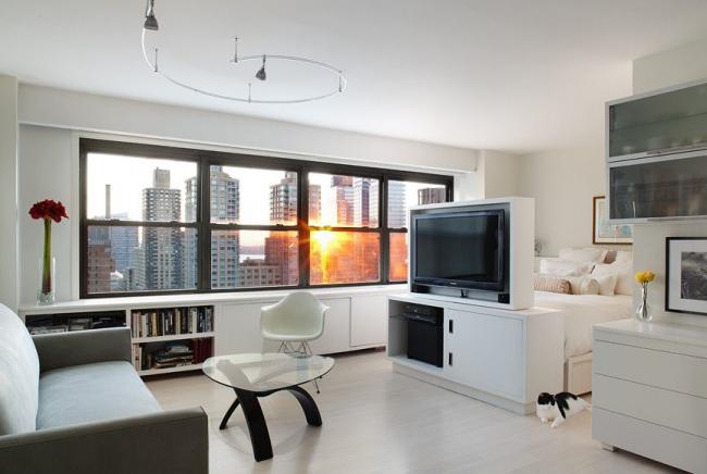 Un meuble TV servira d'excellente bordure de deux zones