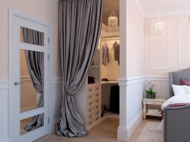 Si la superficie de la chambre le permet, alors en utilisant une cloison, vous pouvez organiser un dressing