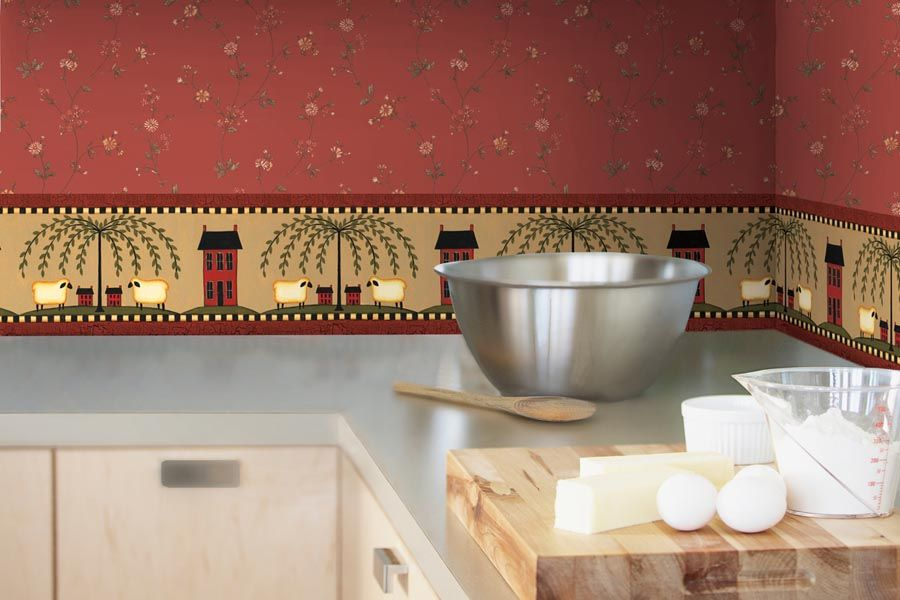 Un beau papier peint lavable expressif s'intégrera parfaitement dans la composition globale de l'intérieur de la cuisine sans perturber l'harmonie