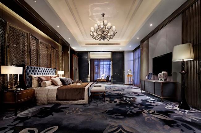 Des tapis aux tons riches et profonds peuvent également être utilisés dans ce style.