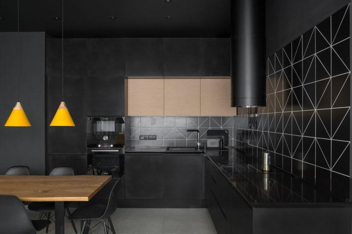 finition à l'intérieur de la cuisine dans des tons noirs