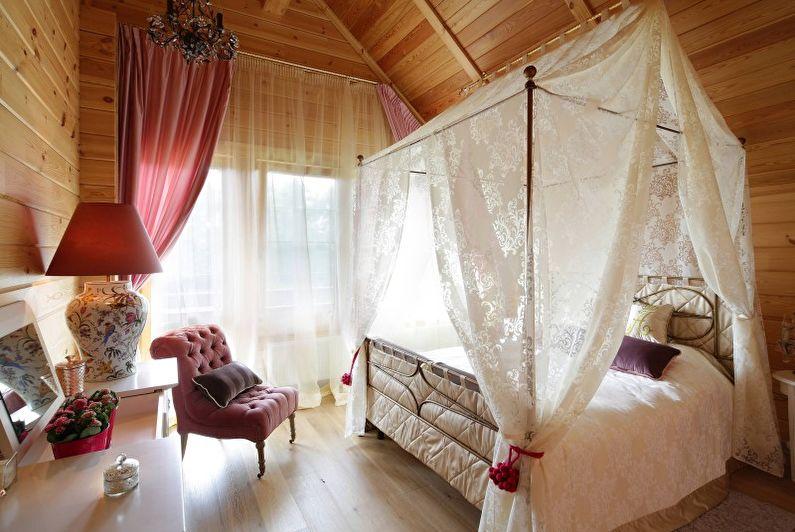 Chambre à coucher dans un style campagnard - Photo de design d'intérieur