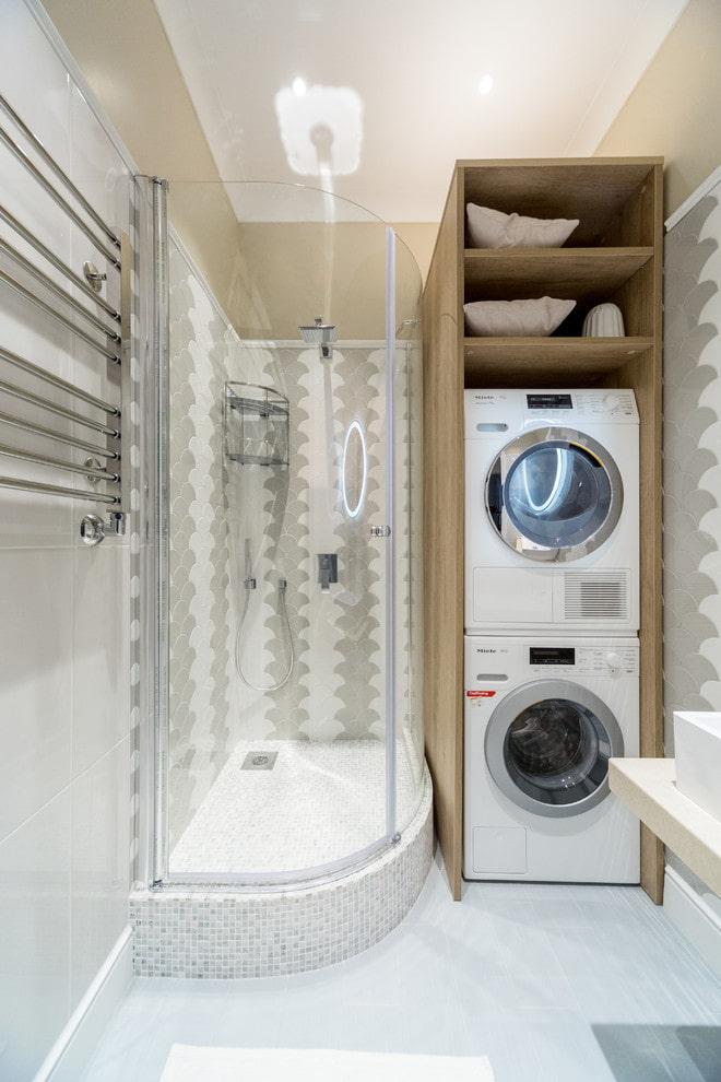 Salle de douche avec meuble pour machine à laver
