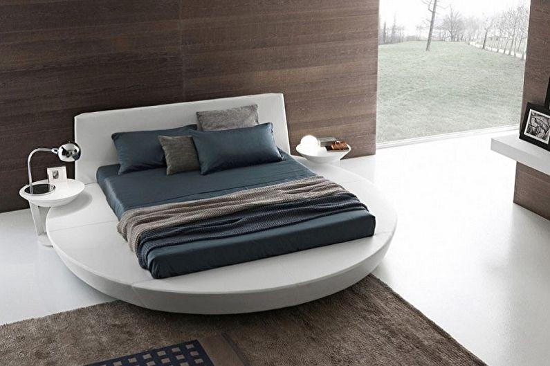Types de lits ronds dans la chambre - Lit rectangulaire sur un podium rond