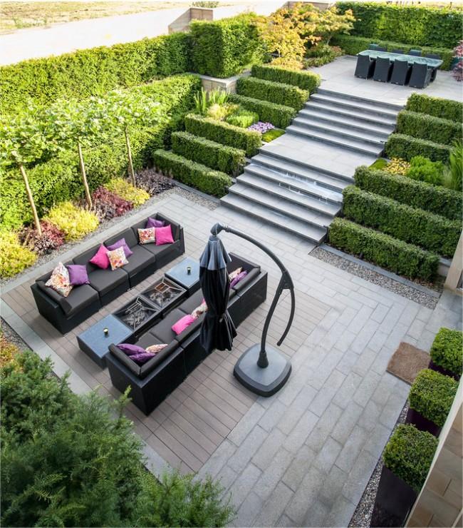 Aménagement paysager en buis et aménagement paysager d'un quartier pavillonnaire avec marches à différents niveaux