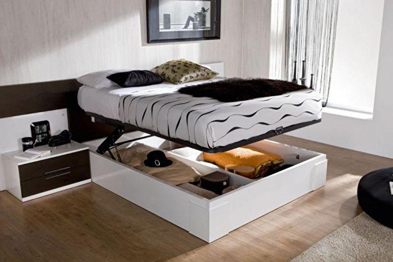 Conception d'un appartement d'une pièce de 33 m².  - Lit avec une boîte à la place des jambes