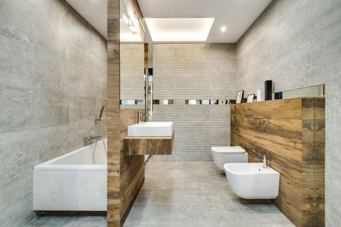 la combinaison de carreaux imitation bois avec du béton à l'intérieur de la salle de bain