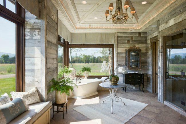 Salle de bain avec une vue magnifique sur les espaces verts