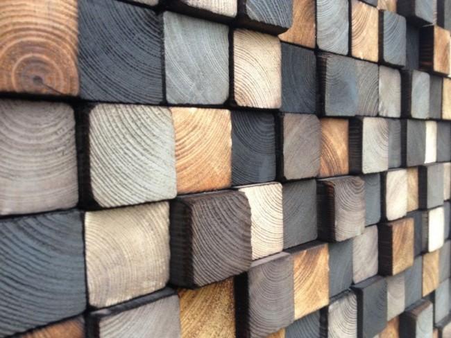 Décoration murale avec des coupes de poutres en bois