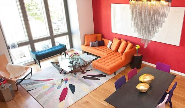 Tapis à l'intérieur du salon.  Pour un intérieur lumineux dans un style moderne, il est préférable de choisir des tapis fabriqués en usine en matériaux artificiels - ils conservent leur forme plus longtemps que les autres.