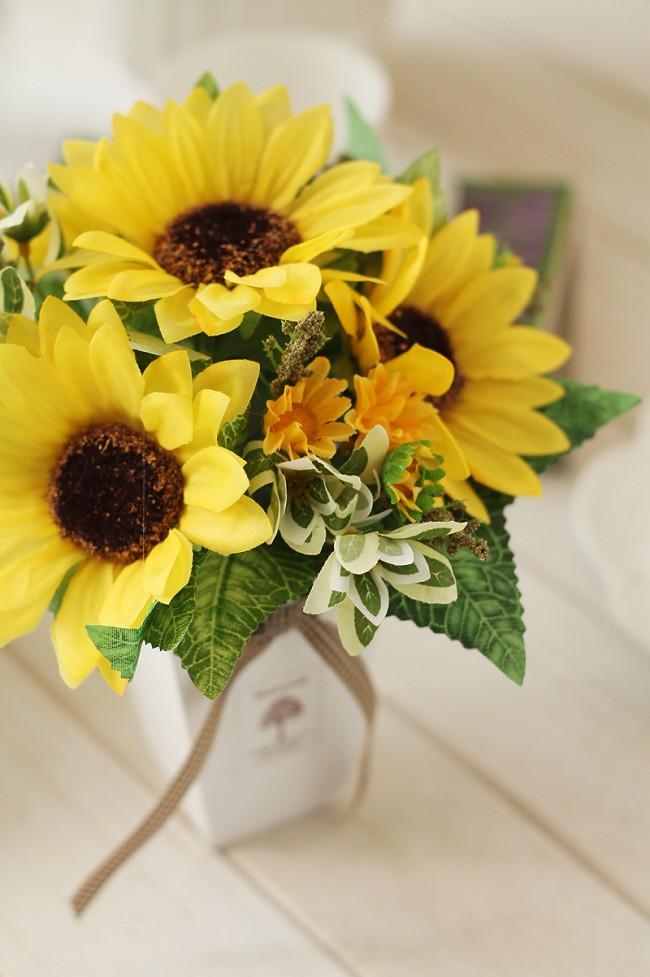 En termes de beauté, de telles compositions ne sont pas inférieures aux compositions de fleurs fraîches.