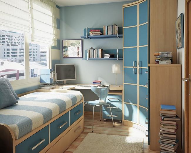 Armoire d'angle en bleu dans une petite chambre