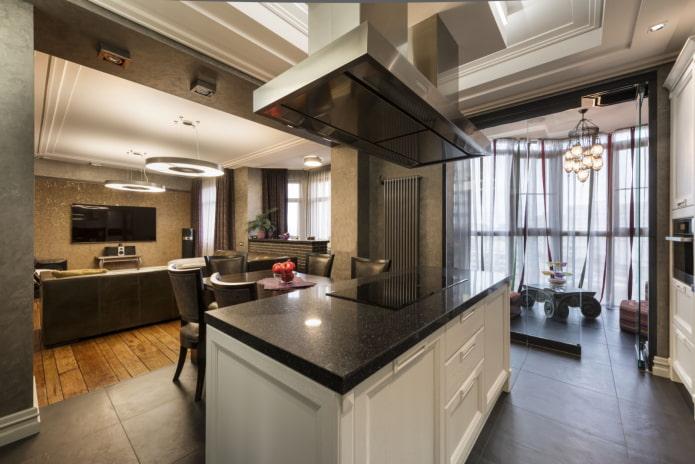 aménagement cuisine-salon avec un élément îlot