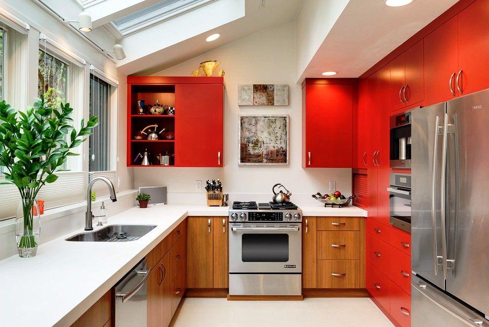 Cette palette de couleurs pour une cuisine intégrée est une excellente option, car le rouge stimule l'appétit et l'argent encourage l'action.