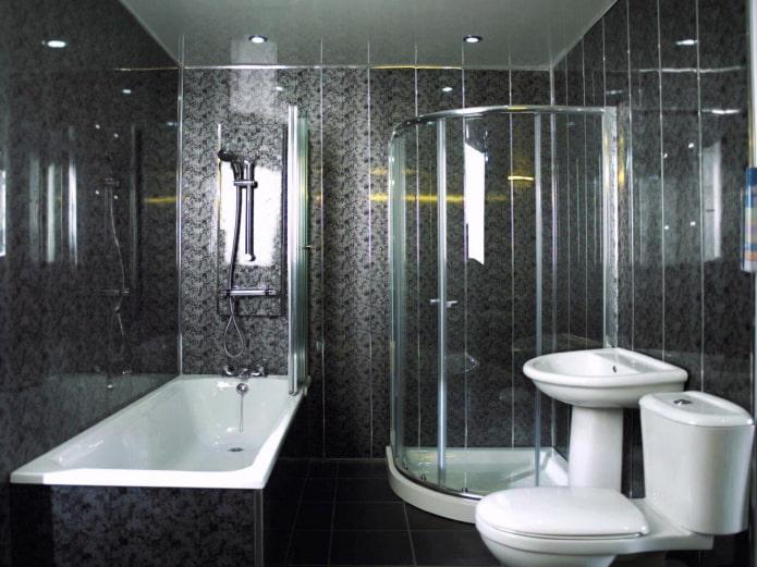 salle de bain finie avec des panneaux en plastique noir