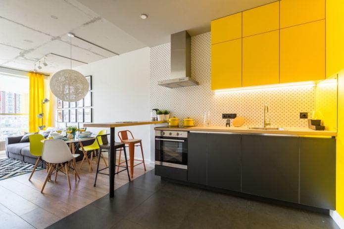 zonage avec matériaux de finition à l'intérieur de la cuisine-salon