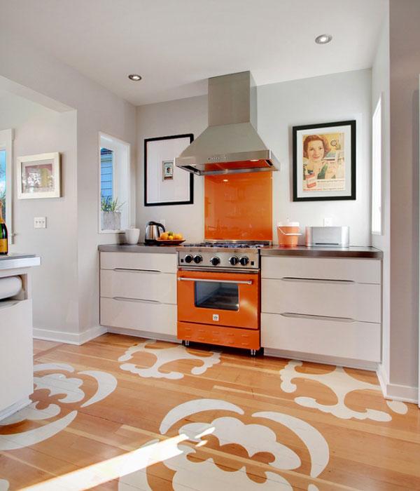 Avec l'ajout de nuances d'orange, toute cuisine pastel prendra du caractère