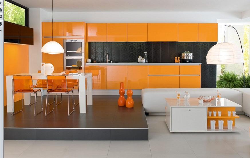 Cuisine orange moderne avec coin repas sur le podium