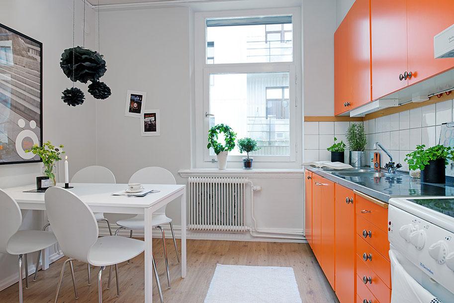 Des accents verts et des plantes animent une cuisine comme celle-ci
