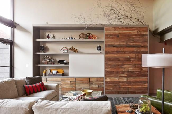 Un bon mur vous aidera à économiser de l'espace dans votre salon.